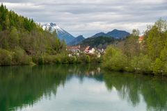 Fussen, romantic Bavarian city in Germany, reflective view on ri Stock Images