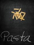 Fussili on Chalkboard with Text. Fussili on old Chalkboard with Text Pasta Stock Images