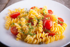 Fussili pasta with watercress and cherry tomatoes. Fussili pasta with watercress and cherry tomatoes Royalty Free Stock Image