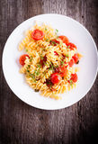 Fussili pasta with watercress and cherry tomatoes. Fussili pasta with watercress and cherry tomatoes Royalty Free Stock Photo