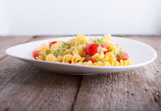 Fussili pasta with watercress and cherry tomatoes. Fussili pasta with watercress and cherry tomatoes Stock Photography