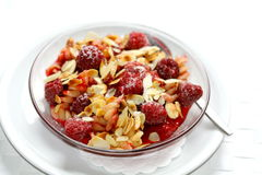 Fussili with raspberries. Pasta and fruit. Fussili with raspberries, little almond sheets and sugar. Simply, fast, low-calorie and very tasty. Dessert Stock Photography