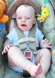 Fussy Baby. Fussy infant boy strapped in carseat stock photos
