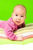 Fussy baby. On the towels royalty free stock photography