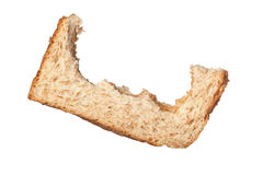 Fussy eater. Bites taken off a slice of bread leaving only the crust isolated on white background royalty free stock photography