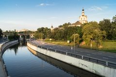View of the Andronikov Monastery and roadway of the river Yauza quay on the clear summer evening, Moscow, Russia. In the fussy noisy Moscow sometimes you want stock image