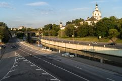 View of the Andronikov Monastery and roadway of the river Yauza quay on the clear summer evening, Moscow, Russia. In the fussy noisy Moscow sometimes you want royalty free stock photography