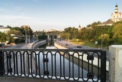 View of the river Yauza and roadway of its embankments from the Kostomarovsky bridge in sunset light, Moscow, Russia. In the fussy noisy Moscow sometimes you stock photos