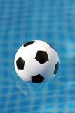 Futball. A football in a pool Stock Photography