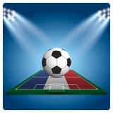 Futbol lub piłka nożna na France flaga z jaskrawym światła reflektorów illumi, Fotografia Royalty Free