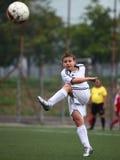 Futbolista con la bola Imagenes de archivo