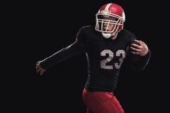 Futbolista en fondo oscuro Fotografía de archivo libre de regalías