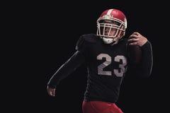 Futbolista en fondo oscuro Foto de archivo