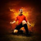 Futbolista en fuegos Foto de archivo libre de regalías