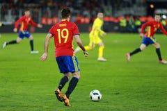 Futbolista en la acción en el campo Imagen de archivo