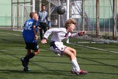 Futbolistas con la bola Fotografía de archivo