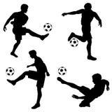 Futbolistas de las siluetas Foto de archivo
