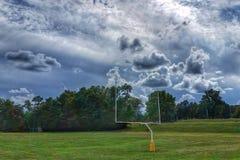 Futbolowa bramkowa poczta w polu Zdjęcie Stock