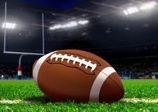 Futbolowa piłka na trawie w stadium Zdjęcia Royalty Free