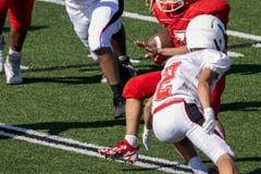 Futbolowy bieg plecy bieg z futbolem zdjęcie stock