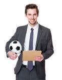 Futbolowy kierownika chwyt z schowkiem i piłki nożnej piłką Fotografia Royalty Free