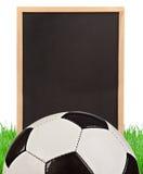 Futbolowy pojęcie - deska trawa Zdjęcia Royalty Free