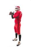 Futbolu amerykańskiego gracz pozuje z piłką na białym tle Fotografia Stock