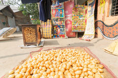 Futchka is being dried for sale at Pingla village, India. PINGLA, WEST BENGAL , INDIA - NOVEMBER 16TH 2014 : Futchka - a street food found throuhout India, made Royalty Free Stock Images