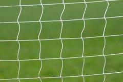 Futebol atrás da rede do objetivo Foto de Stock Royalty Free