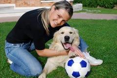 Futebol com cão Fotos de Stock Royalty Free