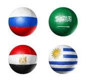 Futebol de Rússia bandeiras de 2018 grupos A em bolas de futebol Fotografia de Stock