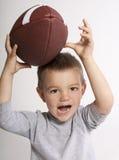 Futebol de travamento da criança Foto de Stock