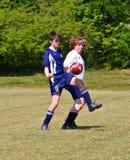 Futebol do menino 12-14 anos velho Foto de Stock Royalty Free