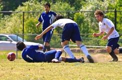 Futebol do menino 12-14 anos velho Fotografia de Stock