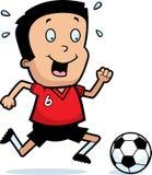 Futebol do menino dos desenhos animados Fotografia de Stock