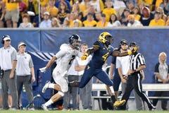 2015 futebol do NCAA - GA @ WVU do sul Foto de Stock