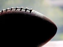 Futebol na silhueta de encontro ao indicador Imagens de Stock Royalty Free