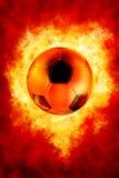 Futebol no incêndio Fotos de Stock Royalty Free