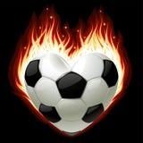 Futebol no incêndio na forma do coração Fotografia de Stock Royalty Free