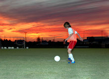 Futebol no por do sol Fotografia de Stock