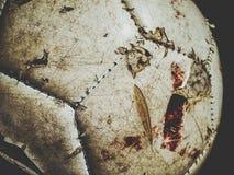 Futebol sujo com traços de sangue foto de stock royalty free