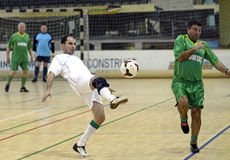 Futsal action. Futsal players pictured in action during an old boys friendly tournament that faced Steaua Bucharest, Dinamo Bucharest, Concordia Chiajna and Stock Image