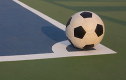 Futsal ball at the corner of field Stock Photos