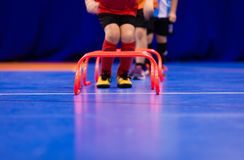 Futsal jumping drills. Futsal indoor soccer training session. Young futsal players exercising for agility and coordination. Sports training session for stock images