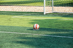 Futsal on penalty area grass field. Royalty Free Stock Images