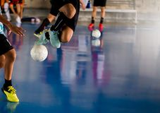 Futsal player jump with trap and control the ball for shoot to royalty free stock photos