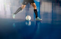 Futsal player trap and control the ball for shoot to goal. royalty free stock photo