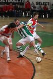 Futsal - Slavia Prague vs. Bohemians Prague. Tomas Matejka from Slavia Prague and Petr Snidl from Bohemians Praha are tackling in the derby match within Jetbull Royalty Free Stock Images
