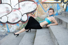 Futufistic fasion model lying on steps Stock Image