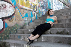 Futufistic fasion model lying on steps Stock Photography